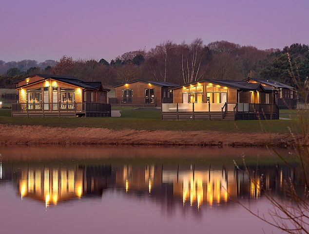 Peaceful: Lakeside lodges at Haulfryn's Delamere Park, which is open in the winter, too